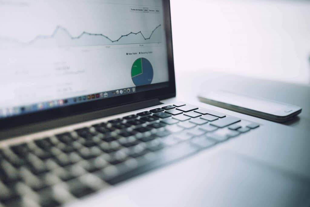 laptop displaying graphs of exchange rates